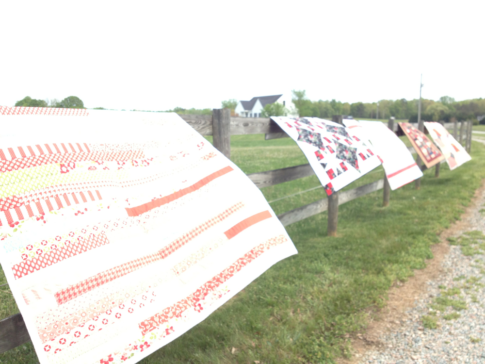 Quilts on a fence...
